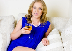 Blonde woman with white wine